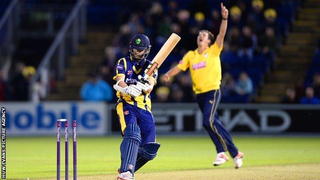 Chris Wood of Hampshire celebrates taking the wicket of Wayne Parnell of Glamorgan