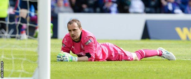 Jamie MacDonald looks on as he is beaten for a second time at Hampden