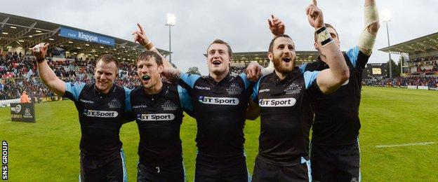 Glasgow players celebrate their maiden Pro12 title victory after a splendid performance