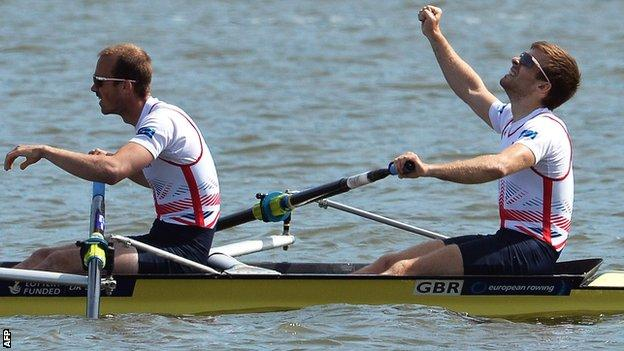 Peter Chambers and Joel Cassells celebrate winning gold in Poznan