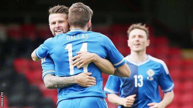Oliver Norwood congratulates goal-scorer Stuart Dallas