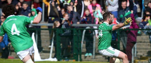 Sean Quigley celebrates his late penalty in front of Fermanagh fans at Brewster Park