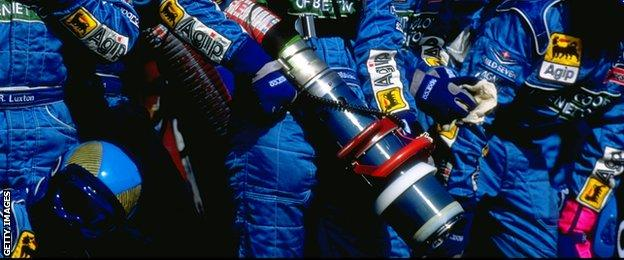 1999: The Benetton pits crew stand ready to refuel the Benetton racing car during the Brazilian Grand Prix in Sao Paulo, Brazil