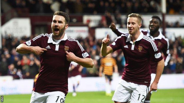 Former Hearts striker James Keatings (left) has signed a two-year deal with Edinburgh rivals Hibernian