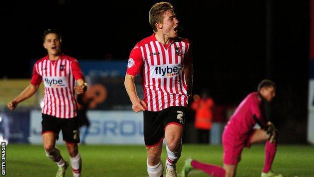 Exeter City celebrate scoring a goal
