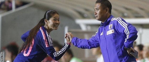 Homare Sawa embraces coach Norio Sasaki during a World Cup warm-up game.