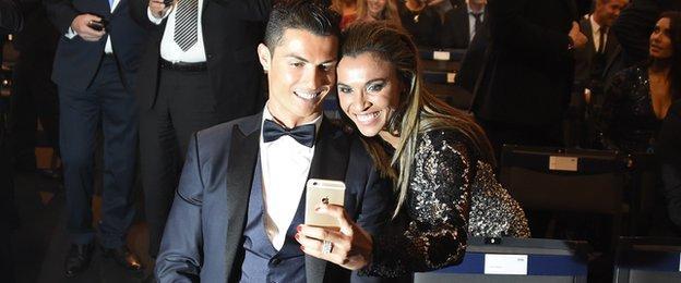 Marta, runner-up for the women's Ballon d'Or award in 2014, poses for a selfie with men's winner Cristiano Ronaldo