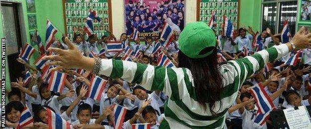 Schoolchildren in Thailand learn a song to support their team at the World Cup