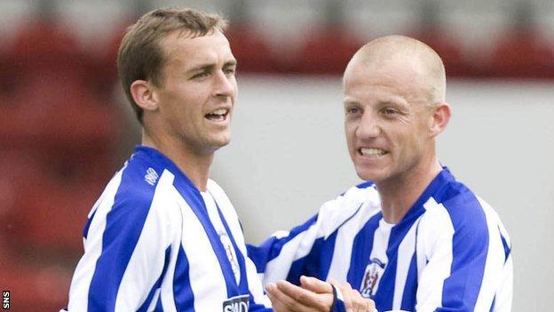 James Fowler and Gavin Skelton celebrate with Kilmarnock