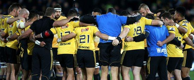 Hurricanes players hold a minute's silence before their game on Friday