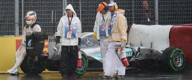 Hamilton calmly signalled to the Canadian crowd who continued to brave the weather.
