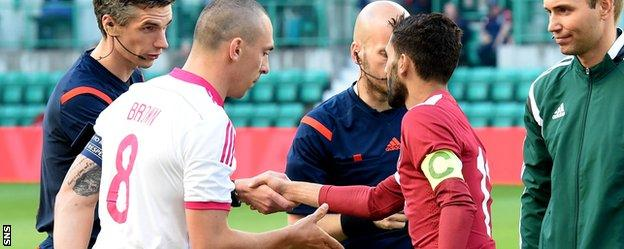 Scotland captain Scott Brown shakes hands with Qatar counterpart Hassan Khalid H Alhaydos