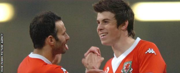 A 17-year-old Gareth Bale (right) celebrates scoring for Wales against San Marino with Ryan Giggs in 2007