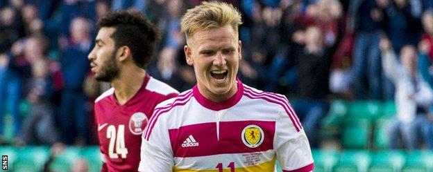 Matt Ritchie celebrates his goal against Qatar