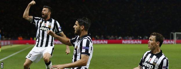Alvaro Morata (centre) celebrates his goal with Andrea Barzagli and Stephan Lichtsteiner
