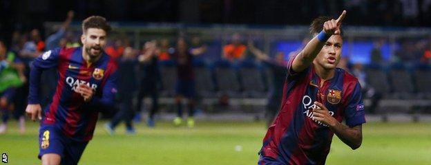 Neymar (right) celebrates his goal