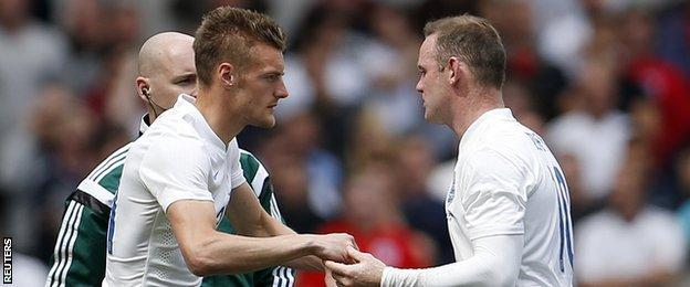 Jamie Vardy (left) came on for Wayne Rooney to make his England debut