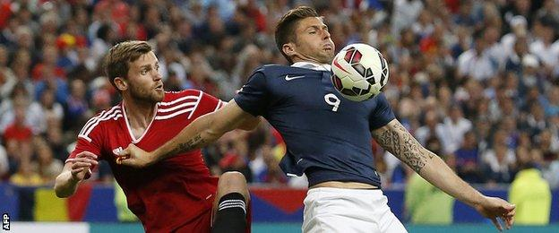 France's Olivier Giroud tries to fend of Belgium defender Nicolas Lombaerts