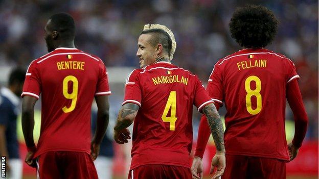 Belgium's Christian Benteke, Radja Nainggolan and Marouane Fellaini celebrate against France