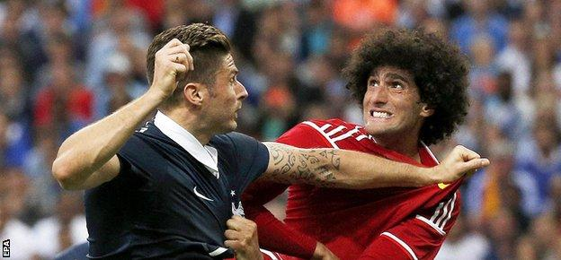 Manchester United forward Marouane Fellaini provides a physical challenge to Belgium's opponents