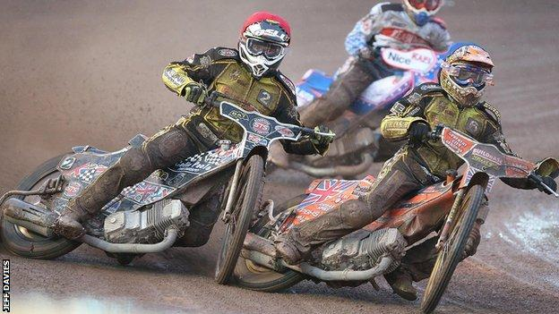 Coventry's Jason Garrity and Poole's Stuart Robson tangled in heat nine in the slippery conditions at Brandon.