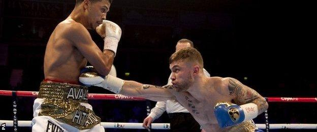 Carl Frampton (right) hits Chris Avalos