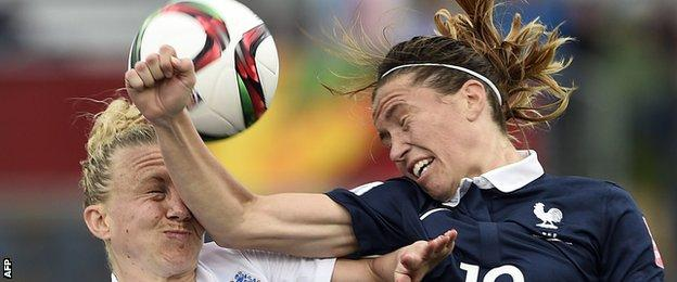 England defender Laura Bassett (L) vies with France midfielder Camille Abily
