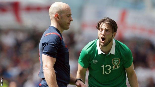 Harry Arter makes a penalty appeal to referee Arnold Hunter during last Sunday's friendly against England