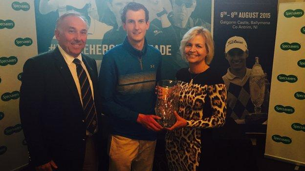 Tiarnan McLarnon receives the North of Ireland Strokeplay trophy from Valerie Penney, with Galgfrom Castle's captain Keith Dinsmore also in the picture
