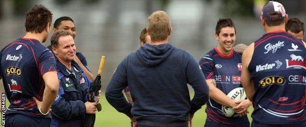 Sydney Roosters players listen to Brian Smith