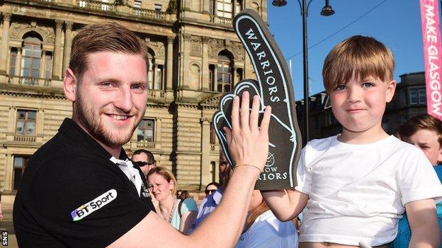 Finn Russell meets a young Glasgow Warriors fan