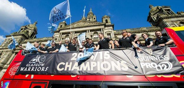 Glasgow Warriors players with the Pro12 trophy on their open-top bus