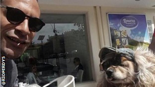 Rio Ferdinand and a dog