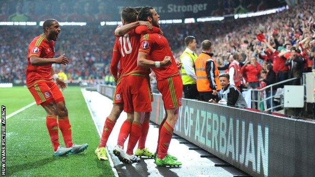 Wales fans celebrate with goal-scorer Gareth Bale in the win over Belgium