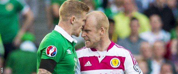Ireland's James McClean and Scotland striker Steven Naismith display the kind of aggression that bubbled away throughout the match