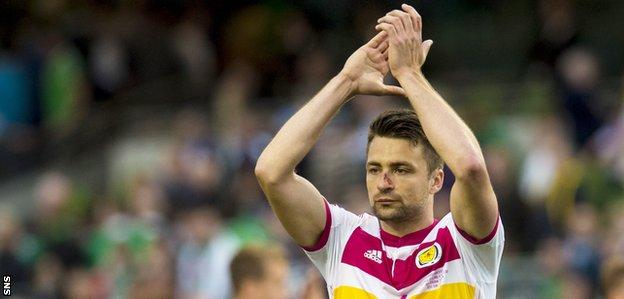 Russell Martin celebrates with the Scotland fans