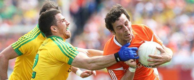Donegal's Paddy McGrath gets to grips with Orchard forward Jamie Clarke at the Athletic Grounds