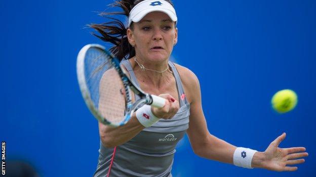 Agnieszka Radwanska returns