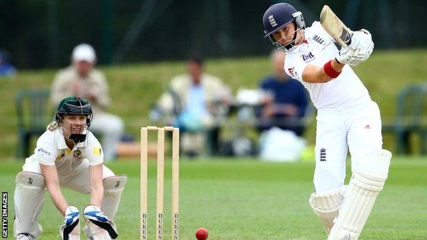 Arran Brindle hits out during the 2013 Women's Ashes, watched by Australia captain Jodie Fields