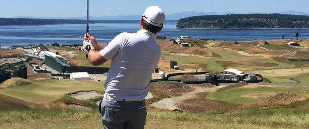 Graeme McDowell hits a tee shot at the ninth at the spectacular Chambers Bay near Seattle