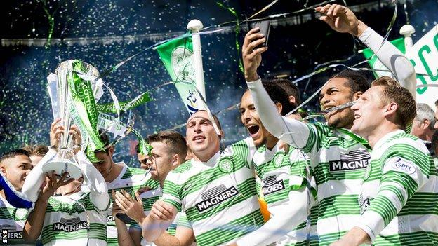Celtic players celebrating with the Scottish Premiership trophy