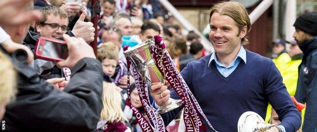Hearts head coach Robbie Neilson with the Scottish Championship trophy