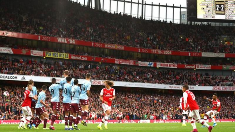 Pierre-Emerick Aubameyang scores a free-kick for Arsenal against Aston Villa