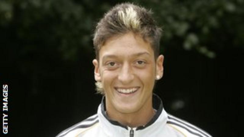 Mesut Ozil: Arsenal sign Real Madrid midfielder for £42.4m