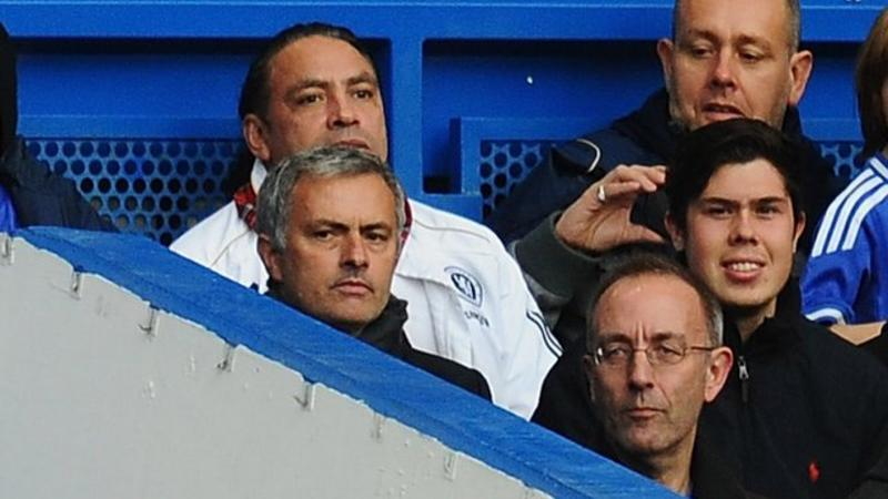 Jose Mourinho: Chelsea manager sits with fans after sending off