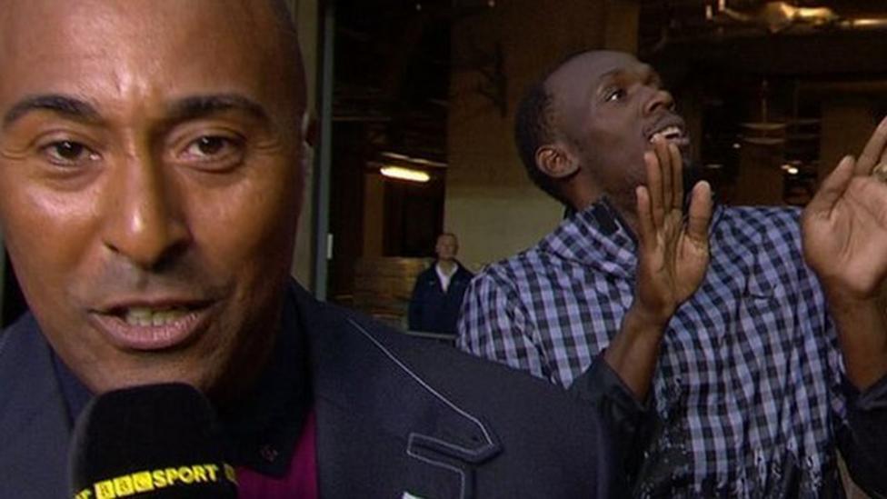 Usain Bolt dances behind BBC presenter