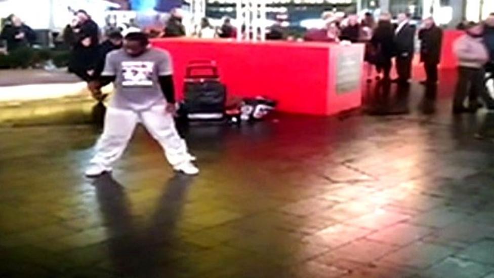 Man breakdances to BBC News theme music
