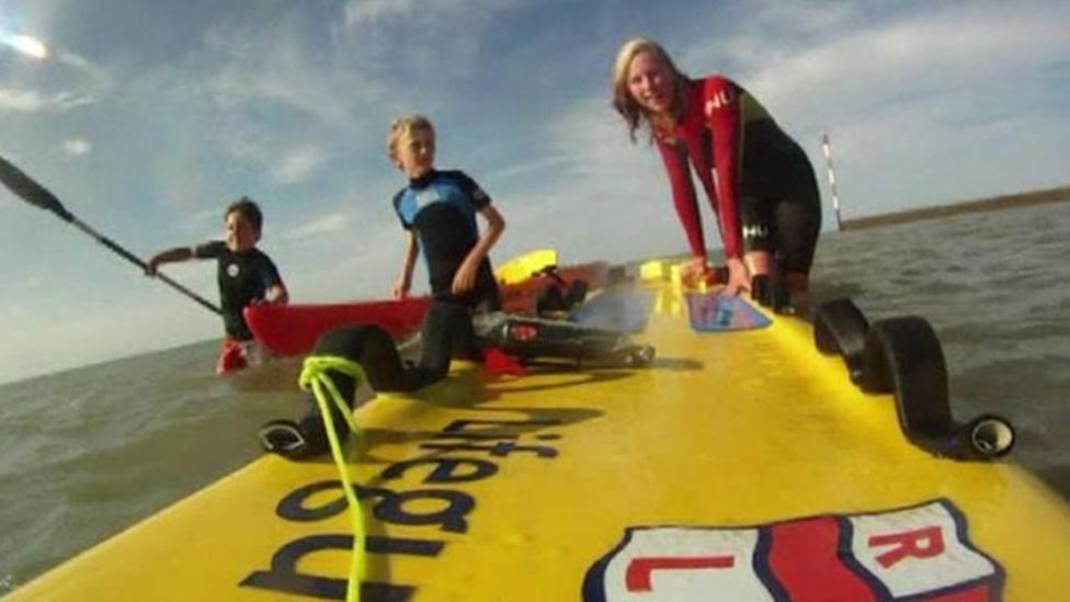 Boys talk about dramatic kayak rescue