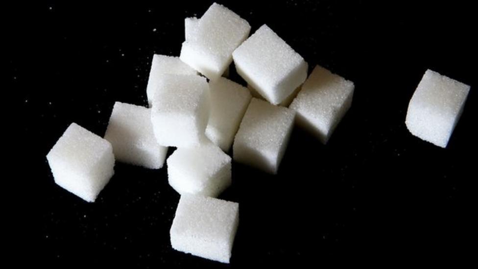 Sugar intake 'should be halved'