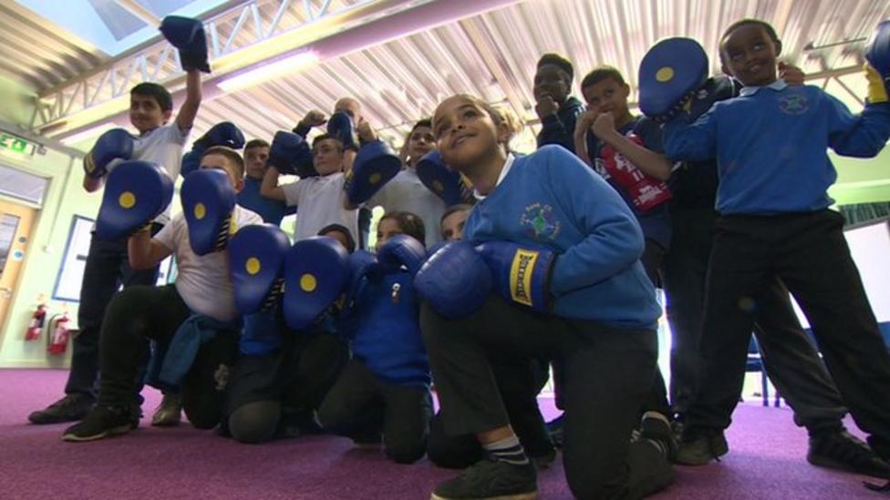 Nicola Adams surprises school boxing club